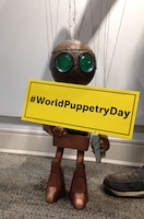 Robot Marionette with #WorldPuppetryDay hashtag Sign